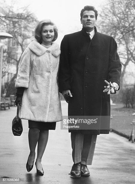 Actors Tom Tryon and Carol Lynley stars of Otto Preminger's film 'The Cardinal' walk together in the Embankment Gardens prior to the premiere of the...