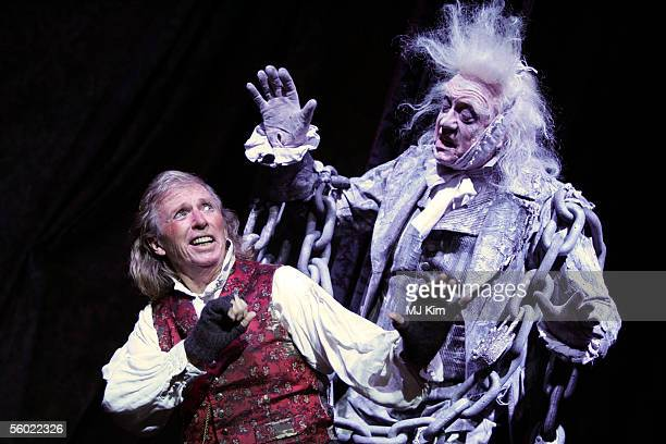 Actors Tommy Steele and Barry Howard pose at a photocall to promote his role as Ebenezer Scrooge in the new stage version of Scrooge at the London...