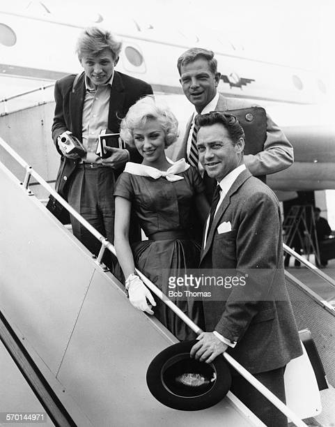 Actors Tommy Steele, Carole Lesley, Peter Arne and Richard Todd boarding their plane to attend the Moscow Film Festival, at London Airport, August...
