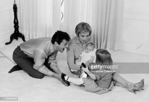 Actors Tony Curtis and Janet Leigh with their children Kelly Curtis and and younger daughter Jamie Lee Curtis in 1959.