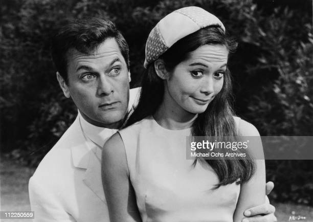 Actors Tony Curtis and Nancy Kwan in a scene from the movie 'Arrivederci Baby' in 1966