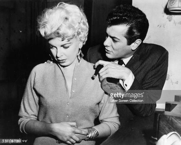 Actors Tony Curtis as Sidney Falco and Barbara Nichols as Rita in the film 'Sweet Smell of Success' 1957
