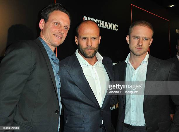 Actors Tony Goldwyn Jason Statham and Ben Foster arrive to the premiere of CBS Films' 'The Mechanic' on January 25 2011 in Los Angeles California