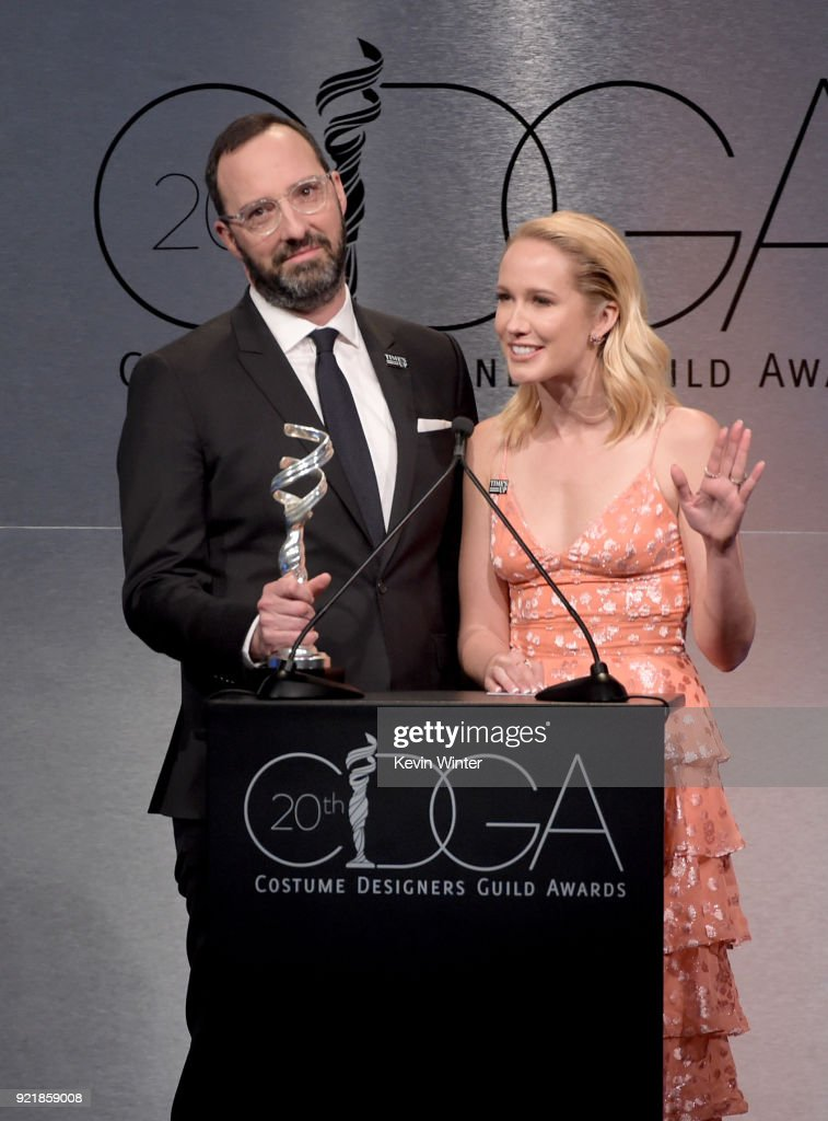 Actors Tony Hale (L) and Anna Camp speak onstage during the Costume Designers Guild Awards at The Beverly Hilton Hotel on February 20, 2018 in Beverly Hills, California.