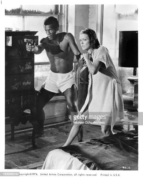 Actors Yaphet Kotto and actress Susan Blakely on set of the United Artists movie Report to the Commissioner in 1975