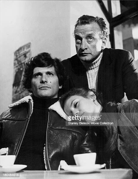 Actors Tony Musante Trish Van Devere and George C Scott in a scene from the movie 'The Last Run' 1971