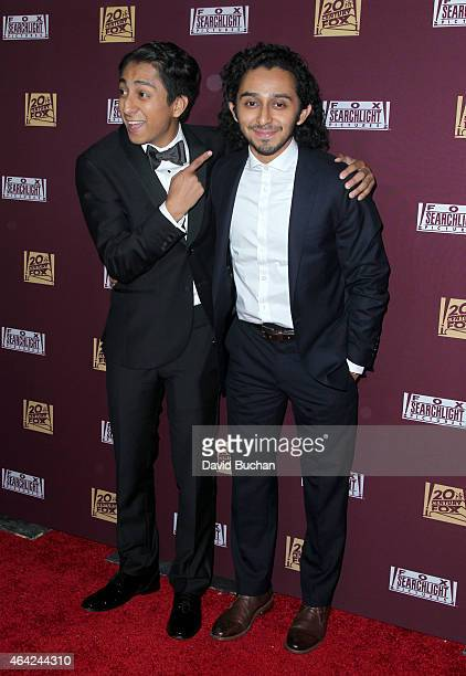 Actors Tony Revolori and Mario Revolori attend the 21st Century Fox and Fox Searchlight Oscar Party at BOA Steakhouse on February 22 2015 in West...