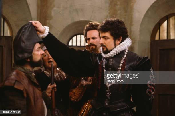 Actors Tony Robinson, Linda Polan, Tim McInnerny and Rowan Atkinson in a scene from episode 'Head' of the BBC television sitcom 'Black Adder II',...