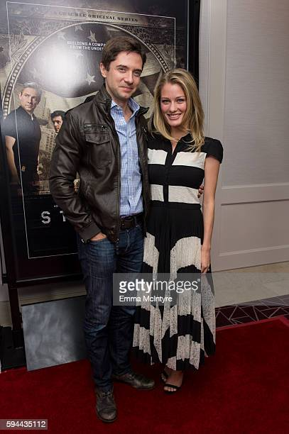 Actors Topher Grace and Ashley Hinshaw arrive at the premiere of Crackle's 'Startup' at The London Hotel on August 23 2016 in West Hollywood...