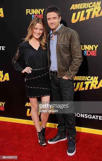 Actors Topher Grace and Ashley Hinshaw arrive at the premiere of Lionsgate's 'American Ultra' at Ace Theater Downtown LA on August 18 2015 in Los...