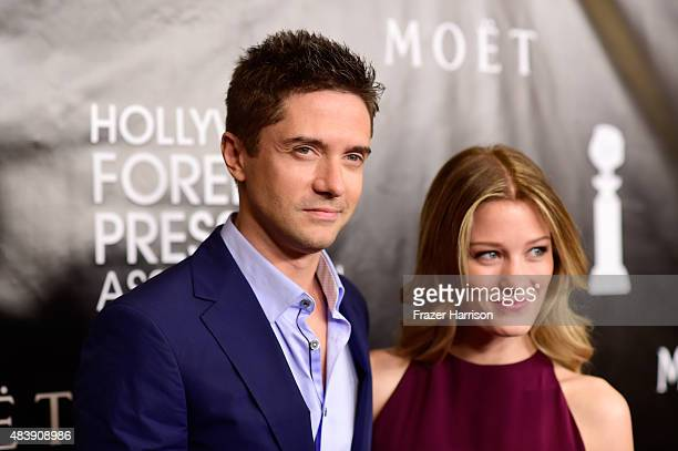 Actors Topher Grace and Ashley Hinshaw attend HFPA Annual Grants Banquet at the Beverly Wilshire Four Seasons Hotel on August 13, 2015 in Beverly...