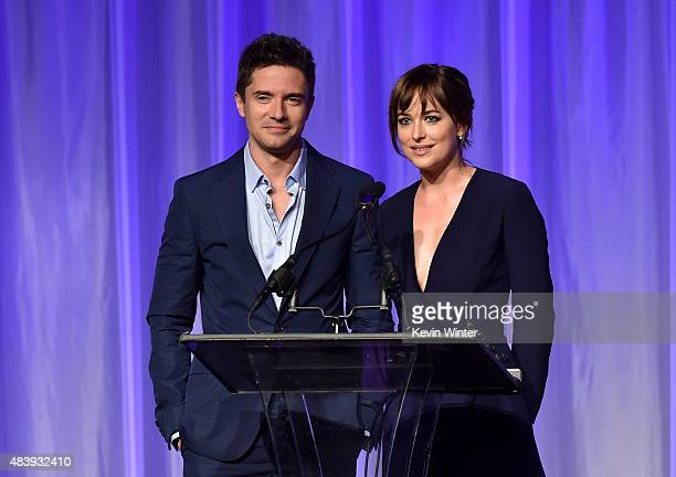 Actors Topher Grace and Dakota Johnson accept grant on behalf of LA County High School for the Arts University of Illinois Ebertfest and Pablove...