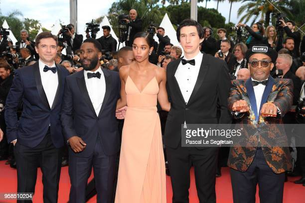 Actors Topher Grace John David Washington Laura Harrier Adam Driver and director Spike Lee wearing knuckle rings with love and hate on them attend...
