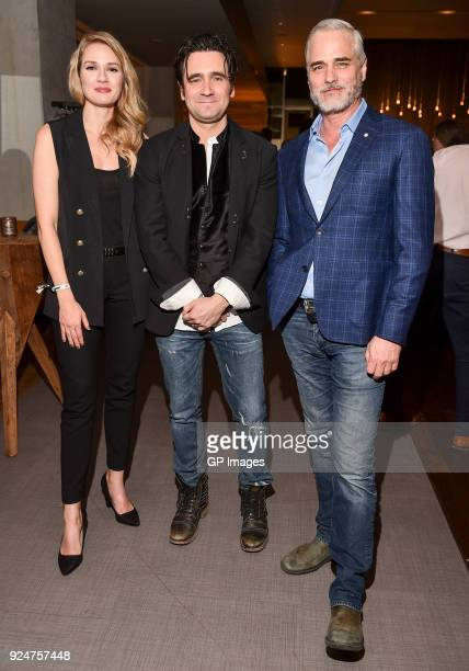 Actors Tori Anderson Allan Hawco and Paul Gross attend the afterparty at CBC hosts world premiere of 'Caught' at TIFF Bell Lightbox on February 26...