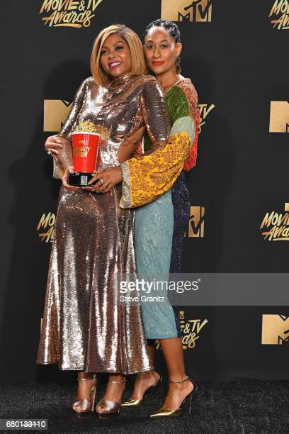 Actors Tracee Ellis Ross and Taraji P. Henson, winner of Best Fight Against the System for 'Hidden Figures', pose in the press room at the 2017 MTV...