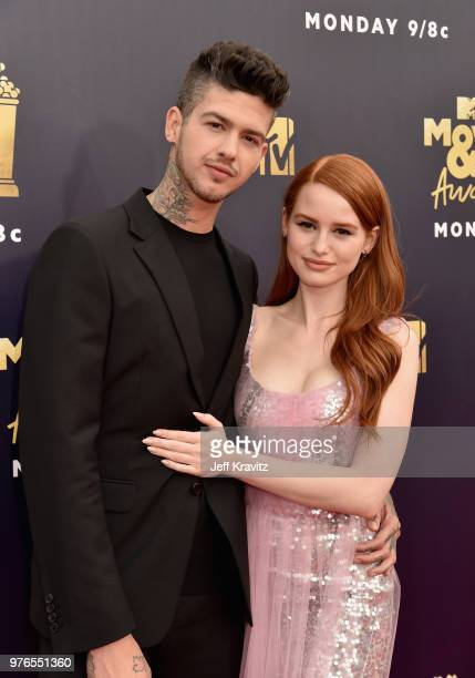 Actors Travis Mills and Madelaine Petsch attend the 2018 MTV Movie And TV Awards at Barker Hangar on June 16 2018 in Santa Monica California