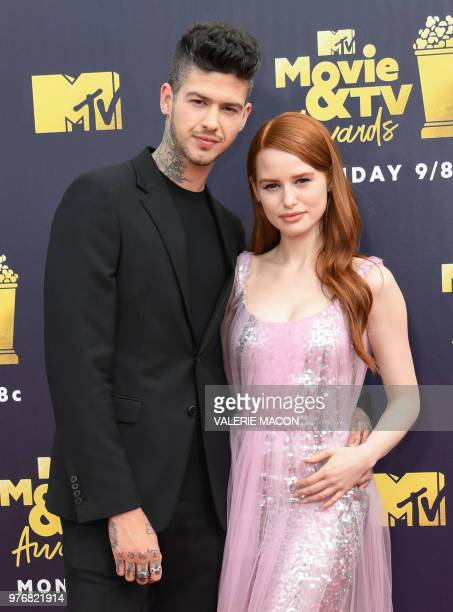 Actors Travis Mills and Madelaine Petsch attend the 2018 MTV Movie TV awards at the Barker Hangar in Santa Monica on June 16 2018 This year's show is...