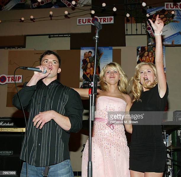 Actors Travis Wester Jessica Boehrs and Molly Schade perform during the after party for the film premiere of Eurotrip at the Cinegrill on February 17...