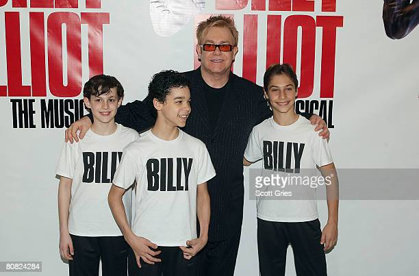 Actors Trent Kowalik, David Alvarez, and Kiril Kulish pose for a photo with Elton John during a press conference to announce the stars of the...