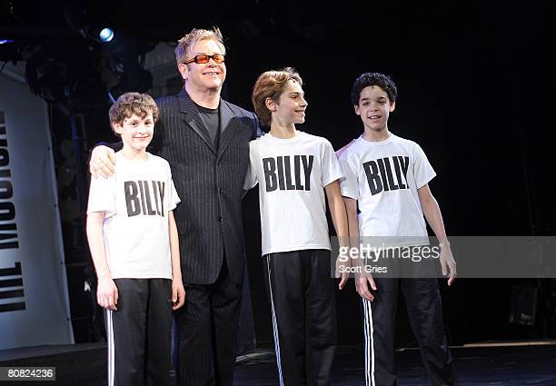 Actors Trent Kowalik, Kiril Kulish, and David Alvarez take a bow with Elton John during a press conference to announce the stars of the upcoming...