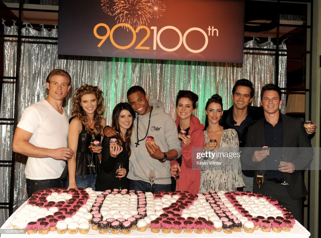 Actors Trevor Donovan, AnnaLynne McCord, Shenae Grimes, Tristan Wilds, Jessica Stroup, Jessica Lowndes, Michael Steger and Matt Lanter pose at the 100th episode celebration of The CW's '90210' at Manhattan Beach Studios on September 27, 2012 in Manhattan Beach, California.
