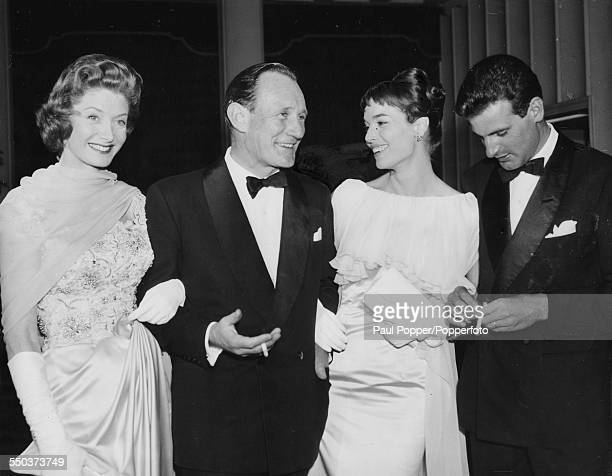 Actors Trevor Howard and Elsa Martinelli attending the premiere of their film 'Manuela' with their respective partners Count Franco Mancinelli Scotti...
