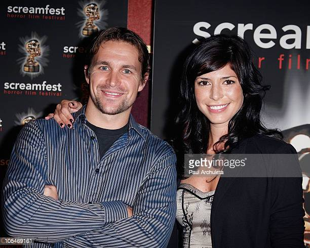 Actors Trevor Matthews and Cindy Sampson arrive for the special Screamfest screening of The Shrine at Mann's 6 Theatre on October 14 2010 in...
