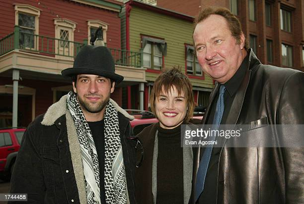 Actors Troy Garity Alison Folland and Randy Quaid at the 'Milwaukee Minnesota' cast photo sessionduring the Sundance Film Festival on January 24 2003...