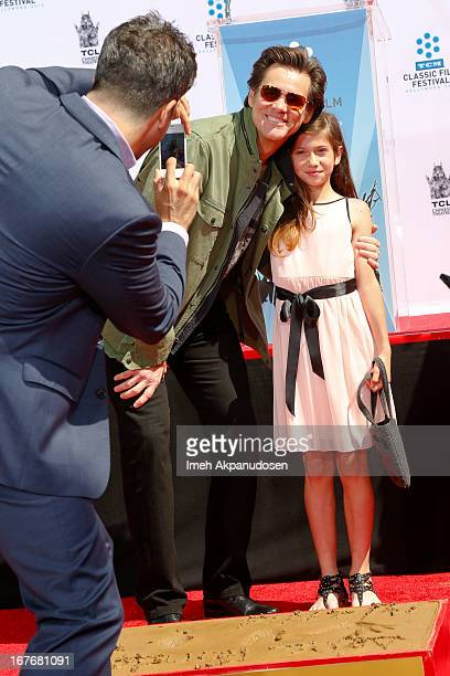 Actors Troy Garity Jim Carrey and Jane Fonda's granddaughter Viva Vadim attend Jane Fonda's hand and footprint ceremony at TCL Chinese Theatre on...