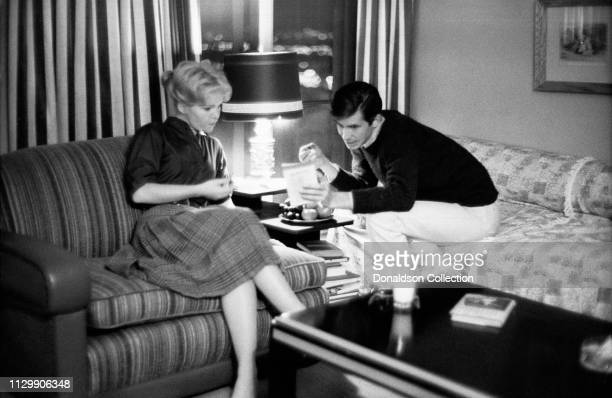 Actors Tuesday Weld and Anthony Perkinslooking over a document in 1968