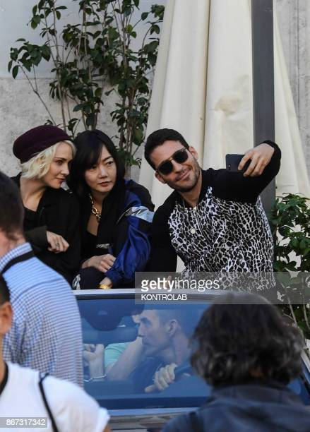 Actors Tuppence Middleton Doona Bae and Miguel Angel Silvestre at a break time the set of Netflix TV scifi series 'Sense8' in the Station in Naples