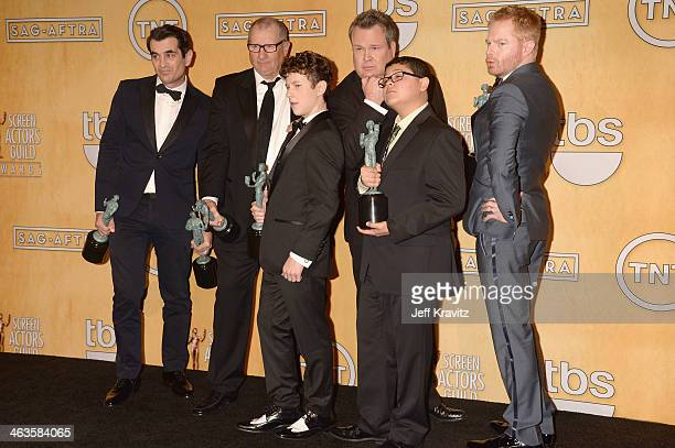 Actors Ty Burrell Ed O'Neill Nolan Gould Eric Stonestreet Rico Rodriguez and Jesse Tyler Ferguson pose in the press room during the 20th Annual...