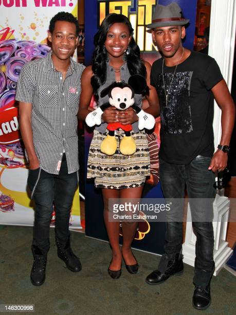 Actors Tyler James Williams Coco Jones and Brandon Mychal Smith attend Disney Channel's 'Let It Shine' Cast Autograph Signing Disney Store on June 13...
