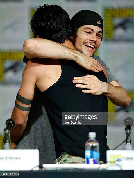 Actors Tyler Posey and Dylan O'Brien embrace onstage at MTV's 'Teen Wolf' panel during ComicCon International 2015 at the San Diego Convention Center...