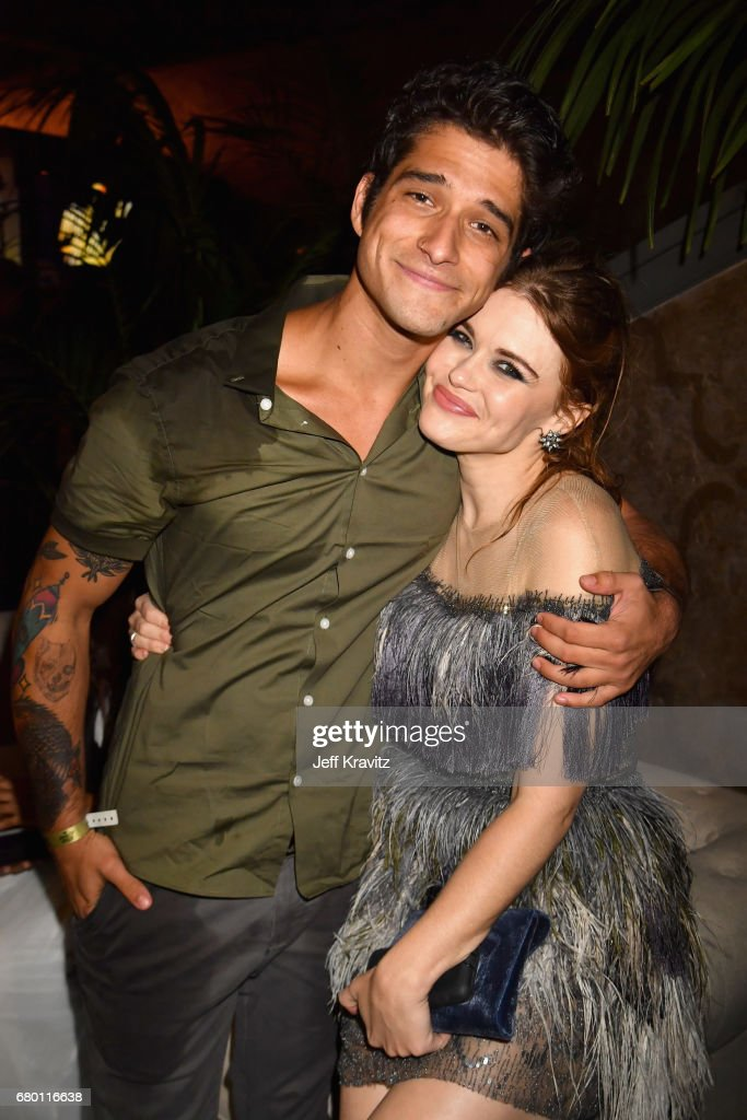 Actors Tyler Posey and Holland Roden attend the 2017 MTV Movie And TV Awards at The Shrine Auditorium on May 7, 2017 in Los Angeles, California.