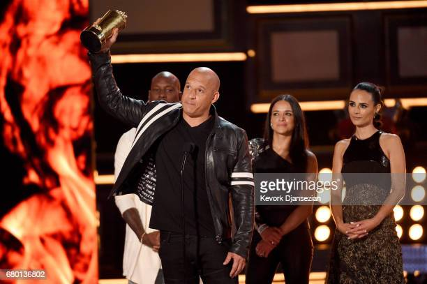 R Actors Tyrese Gibson Vin Diesel Michelle Rodriguez and Jordana Brewster accept the MTV Generation Award for 'The Fast and the Furious' franchise...