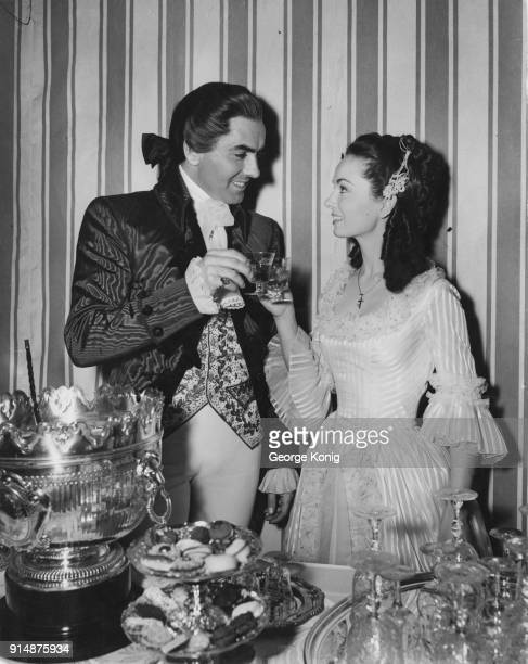 Actors Tyrone Power and Ann Blyth in 18th century costume for a scene in the film 'The House on the Square' at Denham Studios UK 29th March 1951