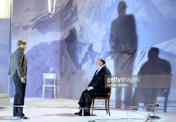 Actors Udo Samel as Cornelius Gurlitt and Anika Meuer as Lise Schmidt perform on stage during a photo rehearsal of the stage play 'Entartete Kunst...