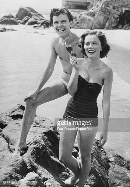 Actors Ulla Jacobsson and Folke Sundquist stars of 'One Summer of Happiness' laughing together on a beach April 28th 1952