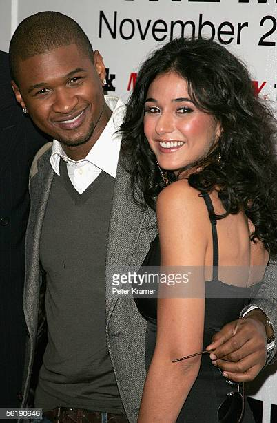 Actors Usher Raymond and Emmanuelle Chriqui attend the premiere of In The Mix at the Chelsea West Cinemas November 16 2005 in New York City