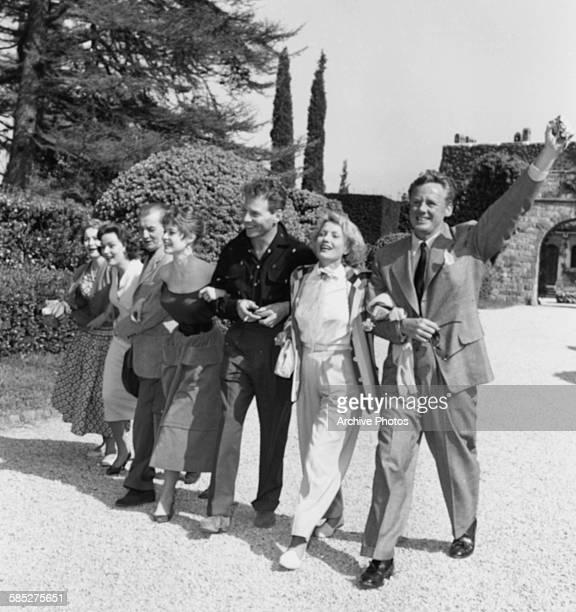 Actors Van Johnson S Miranda Jean Pierre Aumont Brigitte Bardot M Pagnol N Gray and Olivia de Havilland arm in arm at the Cannes Film Festival April...
