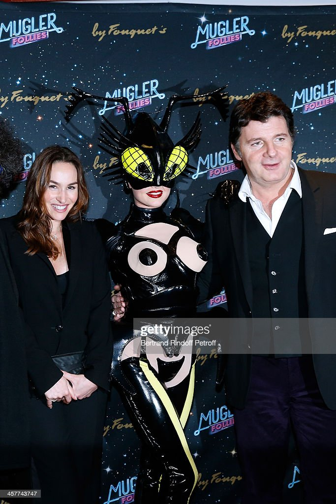 Actors Vanessa Demouy and husband Philippe Lellouche attend the 'Mugler Follies' Paris new variety show premiere on December 18, 2013, held at 'Le Comedia' Theater in Paris, France.