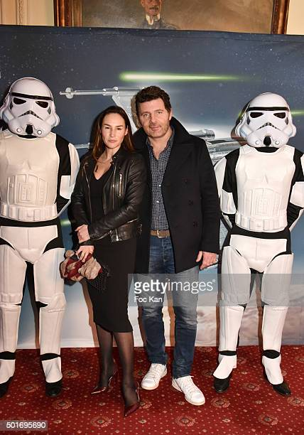 Actors Vanessa Demouy and Philippe Lellouche pose with 'Stormtroopers' during the 'Star Wars Episode VII The Force Awakens' Screening Party Hosted by...