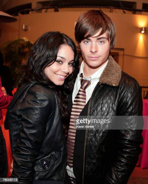 Actors Vanessa Hudgens and Zac Efron pose at the afterparty celebrating the DVD release of Disney Channels' High School Musical 2 Extended Edition at...