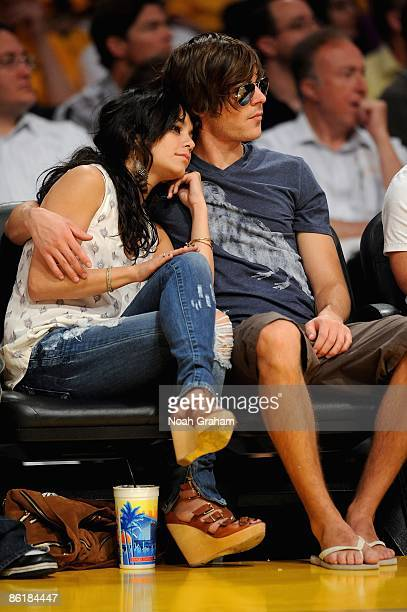 Actors Vanessa Hudgens and Zac Efron sit court side in Game One of the Western Conference Quarterfinals between the Utah Jazz and the Los Angeles...