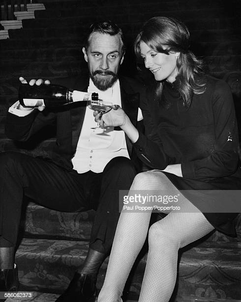 Actors Vanessa Redgrave and Jason Robards drinking champagne as they toast the start of filming of the movie 'Isadora' about the life of the dancer...