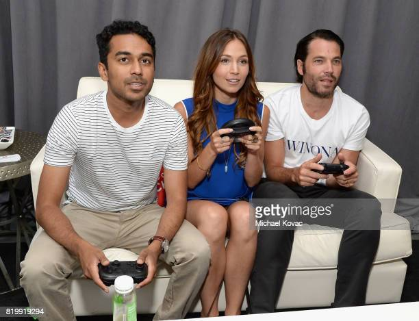 Actors Varun Saranga Melanie Scrofano and actor Tim Rozon from the television series 'Wynonna Earp' stopped by Nintendo at the TV Insider Lounge to...