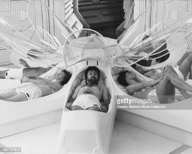 Actors Veronica Cartwright Tom Skerritt Sigourney Weaver and John Hurt part of the crew of the Nostromo awakening from stasis in a scene from the...
