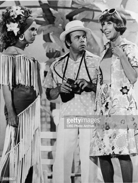 Actors Vicki Lawrence, Tim Conway and Carol Burnett wear casual tourist clothing on stage in a sketch from the TV comedy series, 'The Carol Burnett...
