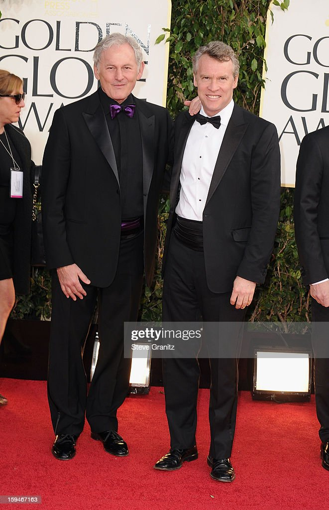 Actors Victor Garber (L) and Tate Donovan arrive at the 70th Annual Golden Globe Awards held at The Beverly Hilton Hotel on January 13, 2013 in Beverly Hills, California.